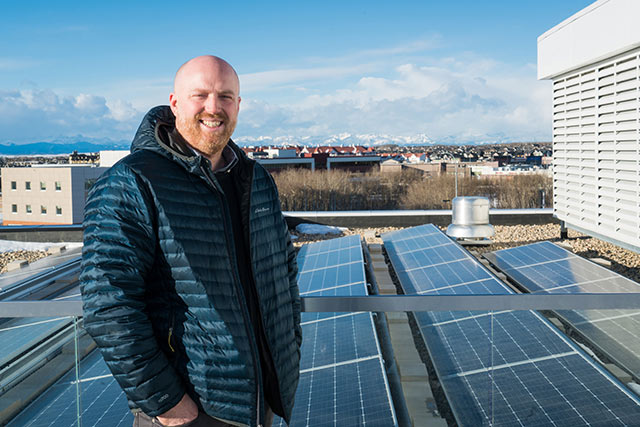 Danny-on-the-roof-with-solar-panels.jpg